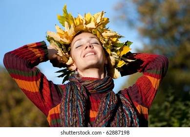 Lovely little woman with autumn wreath on her head