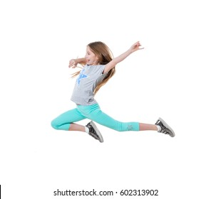 Lovely long-haired girl dancing and feeling good, wearing gray shirt and greenish pants, isolated