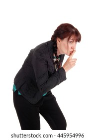 A lovely middle age woman walking bend over with one finger over