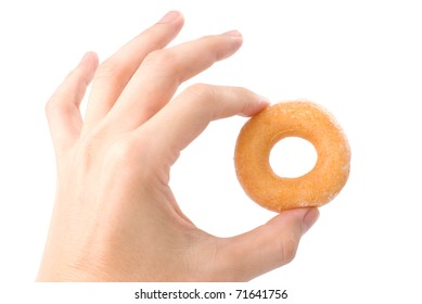 Lovely mini donut in man's hand isolated on white background