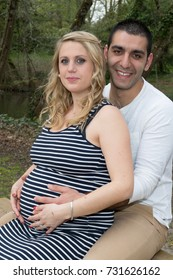 lovely mixed couple north african man blond woman pregnant