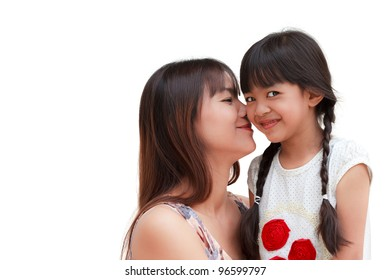 Lovely mother kissing her daughter