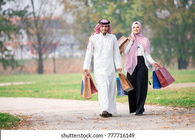 Lovely muslim couple taking a walk after shopping. concept