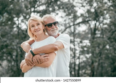 lovely older couple was hug at Park and looking sky together, happy Life after retirement concept
