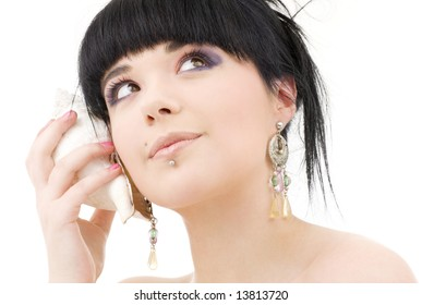 lovely oriental girl with shell over white