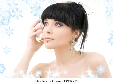 lovely oriental girl with shell and snowflakes