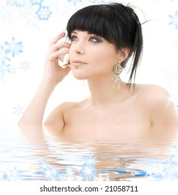 lovely oriental girl with shell in water