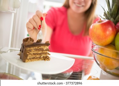 Lovely piece of chocolate cake attracts girl to take it