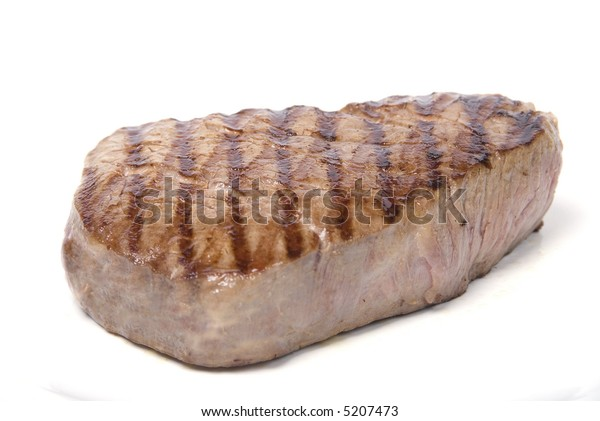 A lovely piece of juicy fillet steak shot against a white background