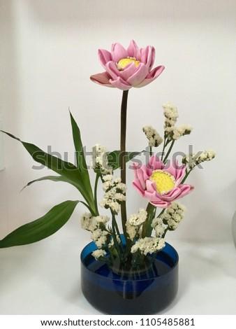 Lovely pink lotus flowers blue vase japanese stock photo edit now lovely pink lotus flowers in blue vasejapanese style flower arrangement artikebana by mightylinksfo