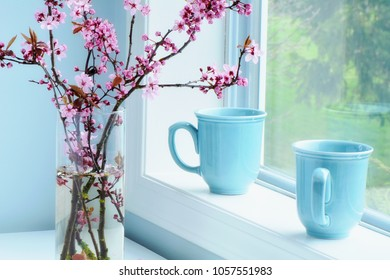 Lovely pink ornamental cherry blossoms in glass vase