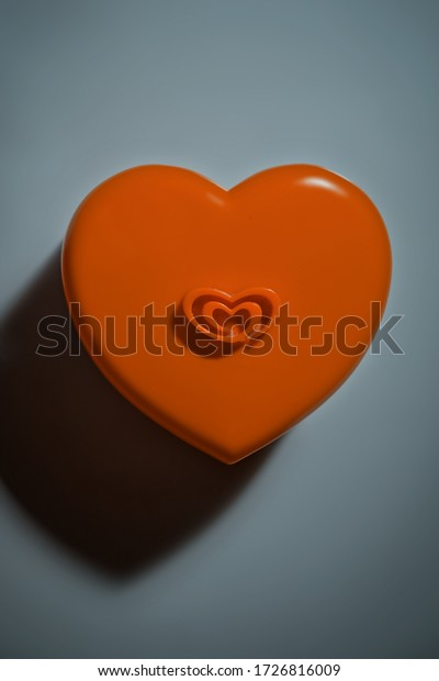 Lovely plastic cookie jar top view with red heart love shape as an idea for gift who you love