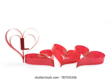 Lovely red Valentine hearts inspirer a theme of LOVE for that special loved one isolated on a white background with clipping path.