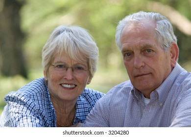 Lovely senior couple outdoors on a summerday (focus on woman)