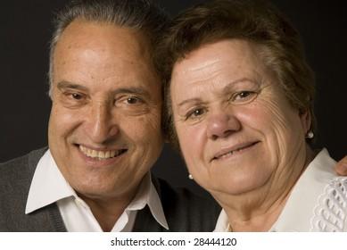 Lovely senior couple still in love on dark background