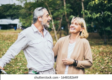 Lovely senior elderly happy couple man and woman with big laughing in romantic moment. Warm heart marriage and lover bonding and relationship. Husband and wife in love. Retired people photo concept