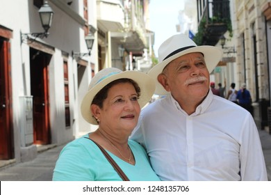 Lovely senior Hispanic couple outdoors close up