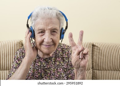 a lovely senior woman listening music