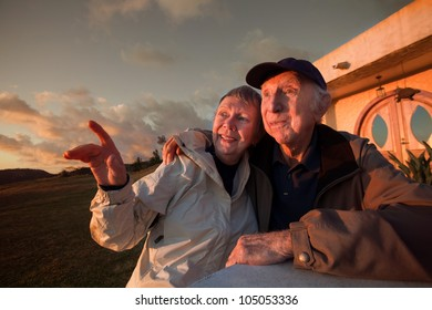 Lovely senior woman with man pointing outside