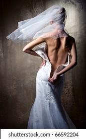 Lovely sensual bride unzip her wedding dress