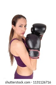 A lovely serious looking woman standing and holding with her black 