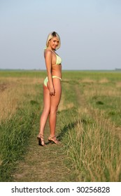 Lovely and sexy young blond girl wearing a bikini.