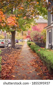 Lovely sidewalk view of a path to the waterfront in Cold Spring, NY.