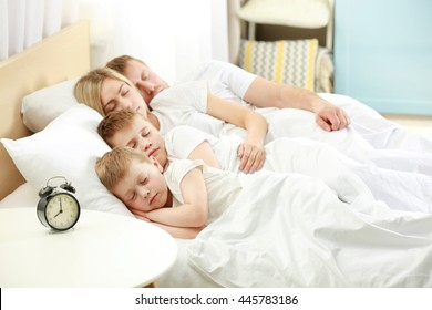 Lovely sleeping family in bed