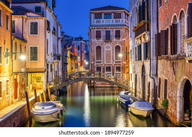 Lovely small canal in Venice at night