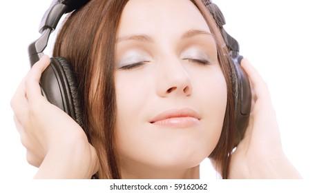 Lovely smiling girl in ear-phones blindly, on white background.