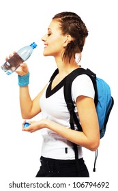 Lovely sporty woman is drinking a fresh water