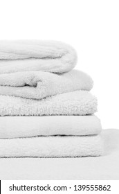 A lovely stack of white bathroom towels isolated on a white background
