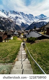 The lovely steps in the village of Mürren in Switzerland on a beautiful summer day.