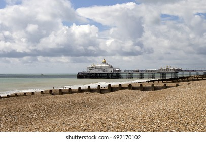 A lovely Sunny day in Eastbourne, England, with views of the beach, the turquoise sea and the famous pier.