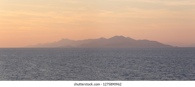 A lovely sunset of pastel hues in Croatia's Dalmatian Coast, facing Korcula Island and the Peljesac peninsula