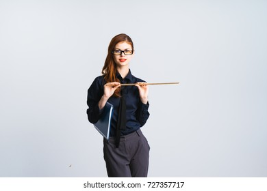 A lovely teacher with a red lipstick holds a ruler and a blue folder in her hands