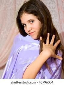Lovely teen girl in violet dress