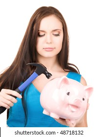 lovely teenage girl with piggy bank and hammer