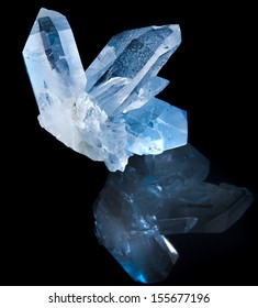 Lovely terminated white rock crystal against black background