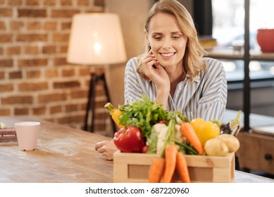 Lovely thoughtful woman deciding what to cook
