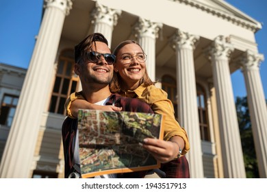 Lovely tourist couple having great time together.