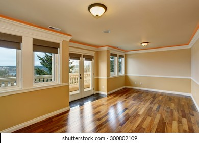 Lovely unfurnished room with hardwood floor and windows.