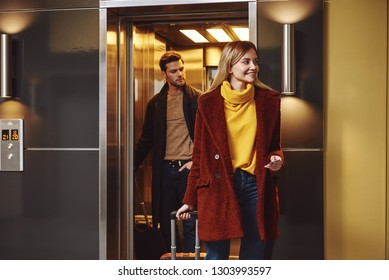 Lovely vacation. Young couple enter to the hotel floor together