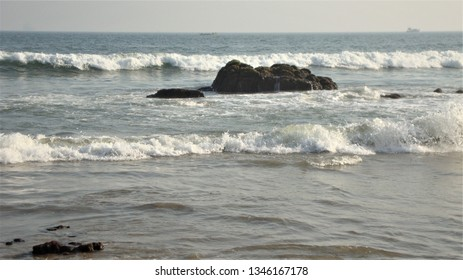 lovely view of coastal sea waves at vizag port, india
