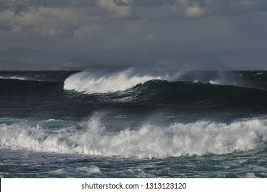The lovely view from Die Punt at Mossel Bay (South Africa) on the big and powerful waves rolling towards the coastline
