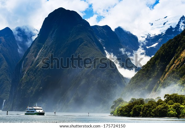 Lovely view of the snow-capped mountains , blue sky, on the beach, among the fjords of New Zealand.