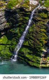 A lovely waterfall or shute, viewed from Tintagel Castle in Cornwall, UK.