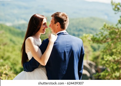 Lovely wedding couple at amazing landscapes with rock Dovbush, Carpathian mountains at Ukraine.
