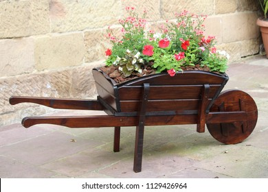 lovely wheelbarrow with flowers very creative and original