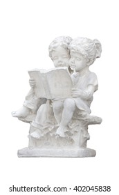 Lovely white plaster figurines reading book isolated on white background